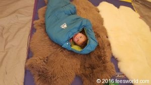 Thing 1 inside a sleeping bag testing out the comfort of the floor with insulation